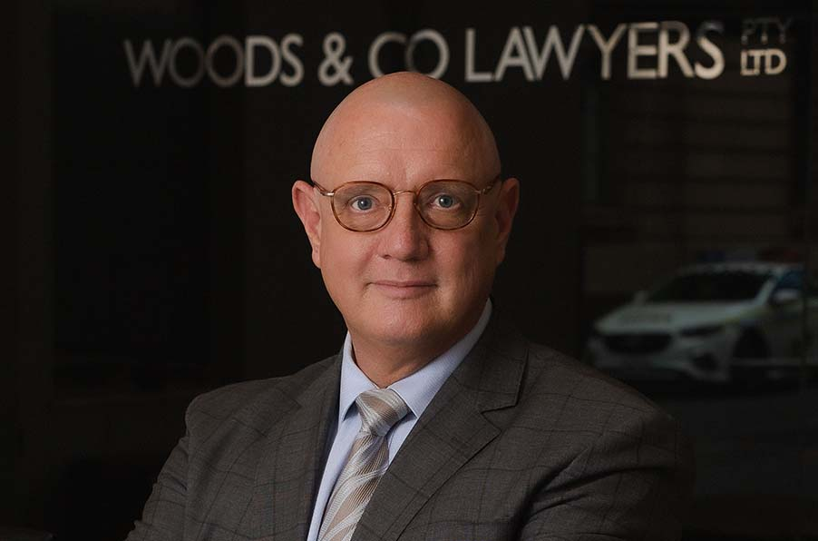 Michael Woods - Solicitor & principal of Woods & Co lawyers